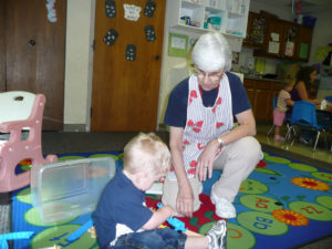 sr corona with kids at st andrews child enrichment center