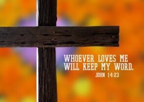 blurry background with wood cross featuring john 14:23