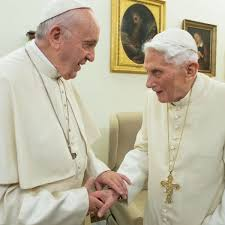 popes shaking hands