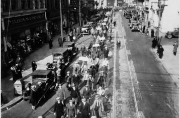 black and white photo of marchers in camden new jersey during great depression