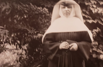 black and white photo of sister standing outside