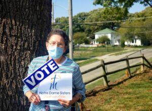 sister with mask and vote sign